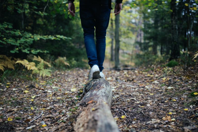 man walking on forest